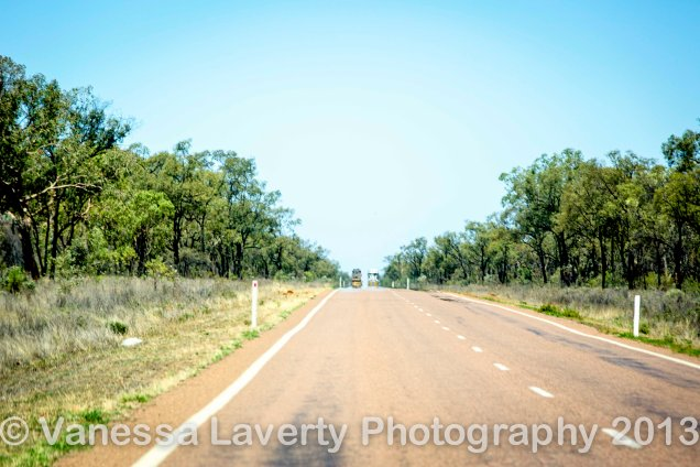 Road trains pass each other in the heat haze of the day